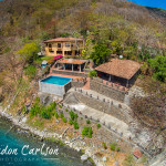 Aerial Photography of House along the Waters of Laguna de Apoyo