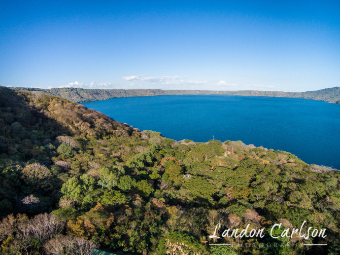 Beautiful Blue Lake View with Trees Looking into the Active Volcano Crater